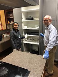 Veneranda Obure and Tim Poe volunteering at the SECU Family House in Chapel Hill